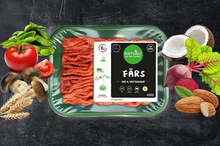 Förpackning med färs i, grönsaker på sidorna