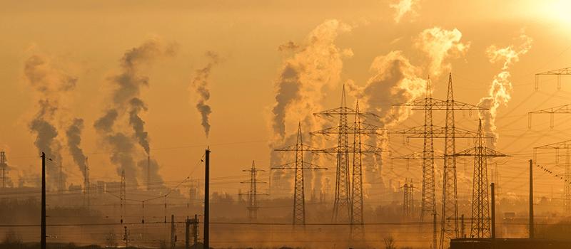 image of smokestacks and smog entering atmosphere