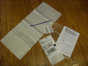 stain stickers, forms, prepaid shipping label and plastic shipping bag