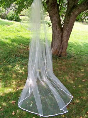 A long blusher veil with ribbon edge