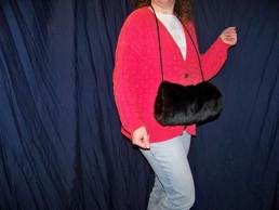 fur muff with shoulder strap