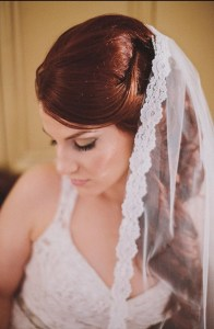 lace mantilla worn with V-neck dress