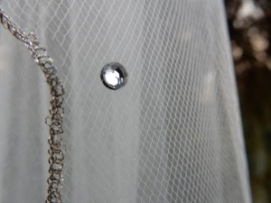 Swarovski rhinestone crystal with silver pencil edge veil