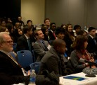 Audience attentively watches the teams present their Business Plans