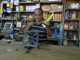 This fellow ran a dry goods store we stopped in. He is repairing a cookstove burner.