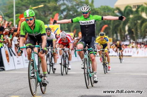 Theo Bos wins a crash-affected sprint on stage two, as teammate Graeme Brown celebrates behind him (Image: Tour de Langkawi)