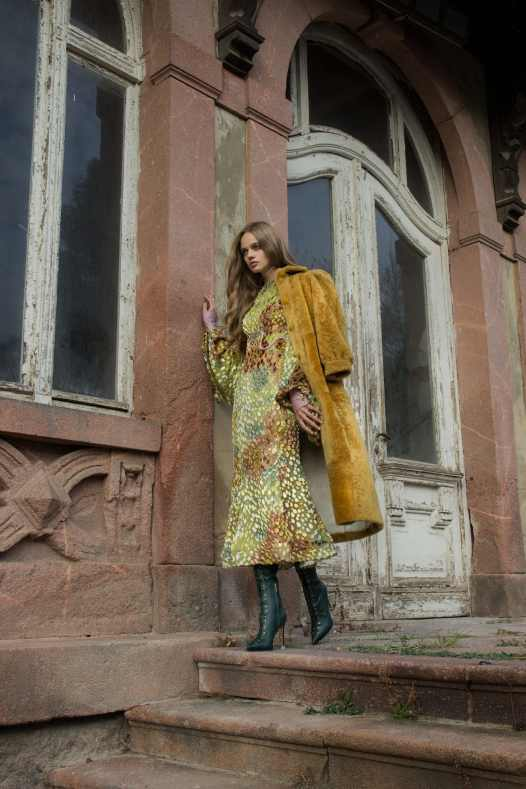 Velvet 3D effect maxi dress, Lana Mueller. Tan coat, Mulberry. Green thighboots, Talbot Runhof