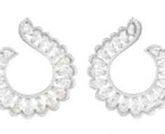 "Chopard earrings from the ""Precious Lace Collection"" featuring 12.82-carats of pear-shaped diamonds and .97-carats of diamonds set in 18k white gold."