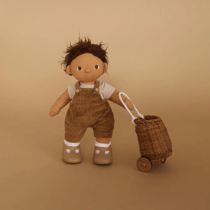 Dinkum doll Sprout wearing Esa overalls set, holding doll luggy in natural. Available from Velvetgear Singapore