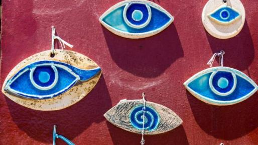 Handmade evil eye beads made of ceramics hanged on the wall for sale