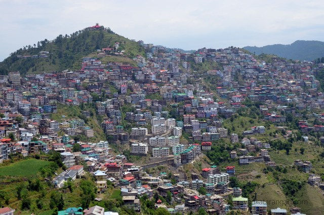 Colourful houses on the slopes, that look like matchboxes