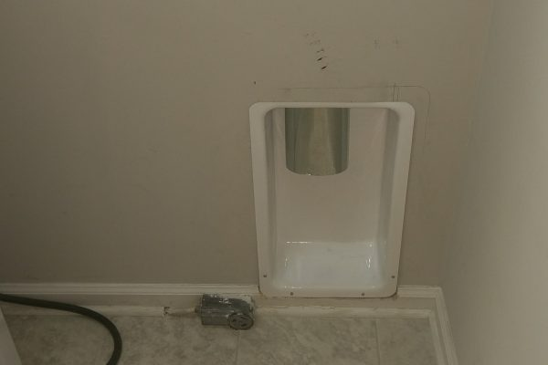 We cleaned up the mess in the laundry room and installed a flush mount dryer box.
