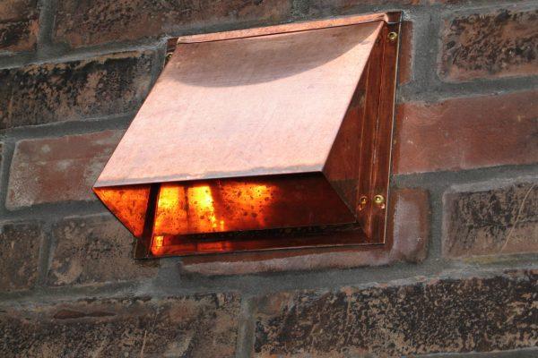 Copper_Wall_Hood_Vent_on_Brick