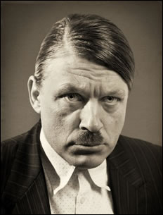 RIchard Herring models the tache