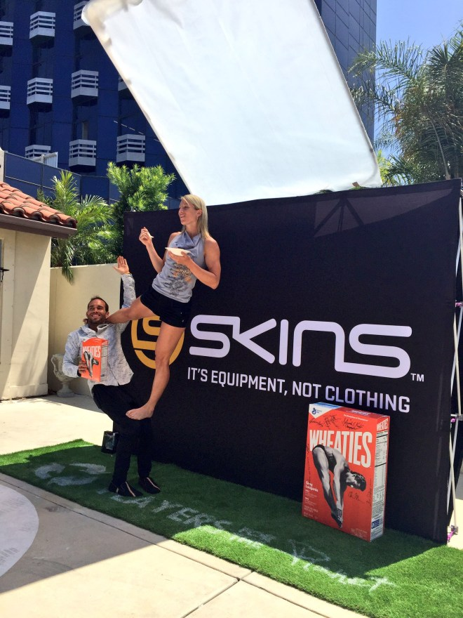 Jessie Graff takes a spoonful of Wheaties while stunting on the green carpet. PHOTO CREDIT: Annette Lee/The Starving Artists Project