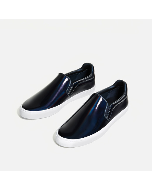 Laceless trainers with elastics. Metallic blue. Matching top-stitching. Laminated effect on the upper. White sole. 95% polyurethane. 5% polyester. 85% cotton. 10% polyurethane. 5% polyester. 100% styrene butadiene rubber. 100% polyurethane. $29