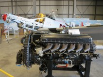 It is rare to see an historic aircraft partially disassembled. Here is the Packard Merlin on a frame outside the aircraft.