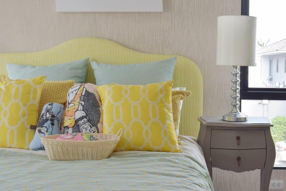 Yellow Headboard on Bed