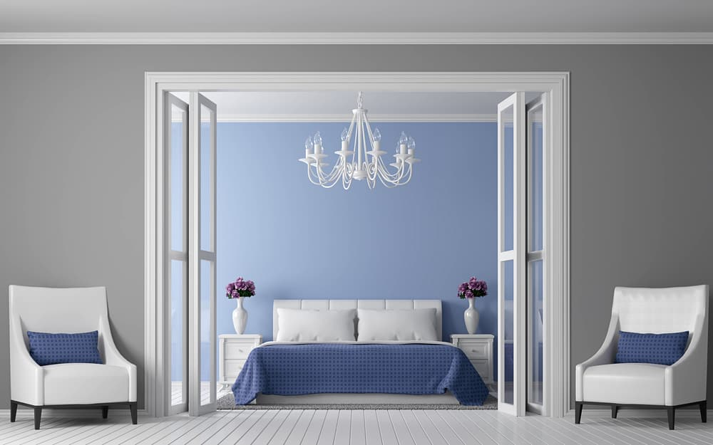 Blue wall in bedroom with chandelier