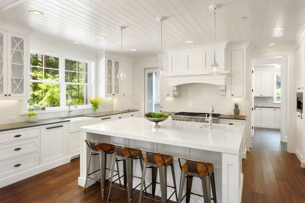 A white kitchen with hardwood floors