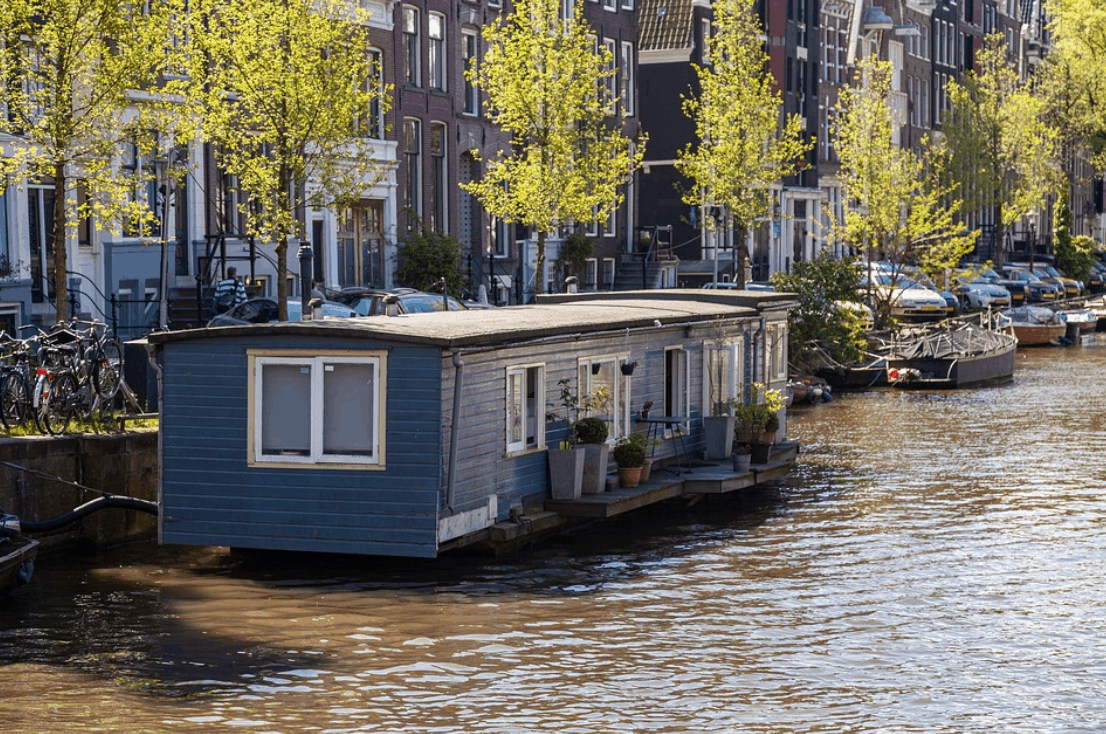 A blue houseboat in the river