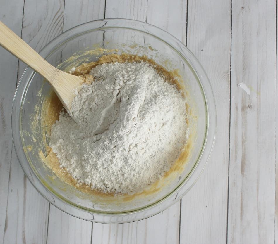 Adding flour to the sugar mixture