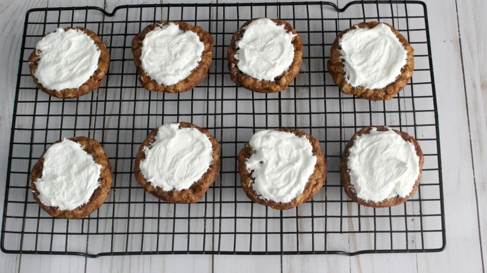 Put marshmallow topping on the oatmeal cookies