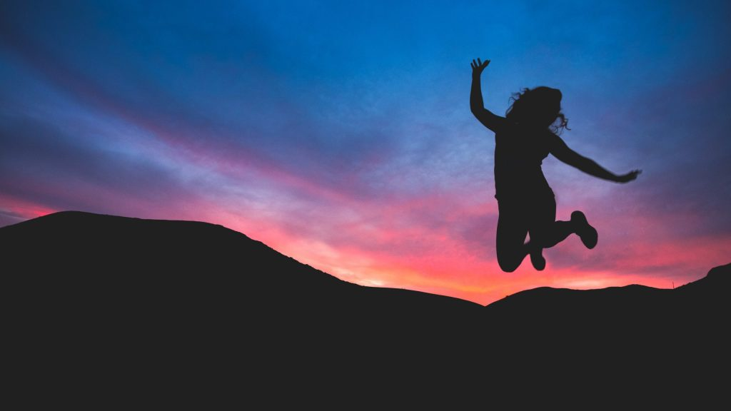 silhouette of girl jumping