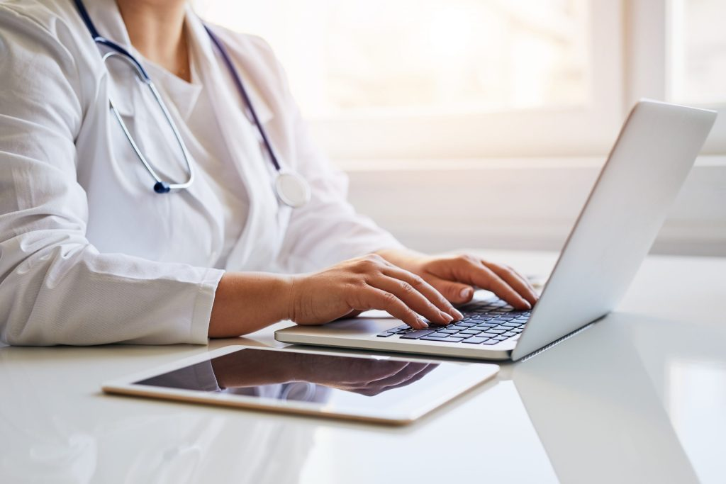 A female doctor at her laptop