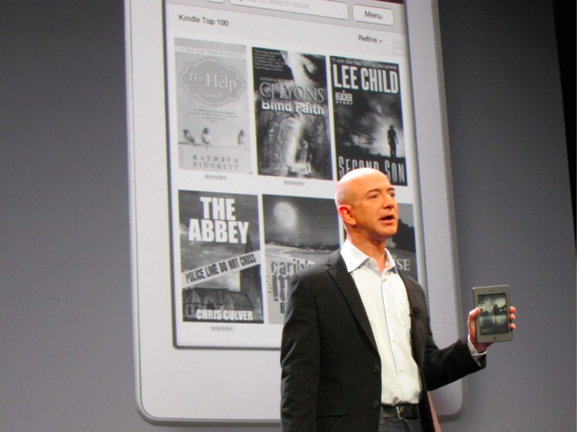 Amazon's Jeff Bezos holding a Kindle Touch
