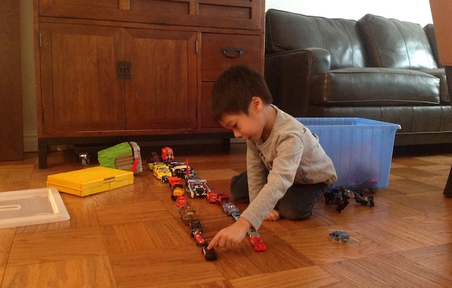 Rocky Agrawal's 4-year-old cousin playing with toy trains