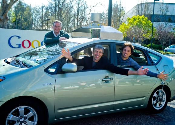 Google executive chairman Eric Schmidt, left, with Google cofounders Larry Page and Sergey Brin in a Google self-driving car in 2011.