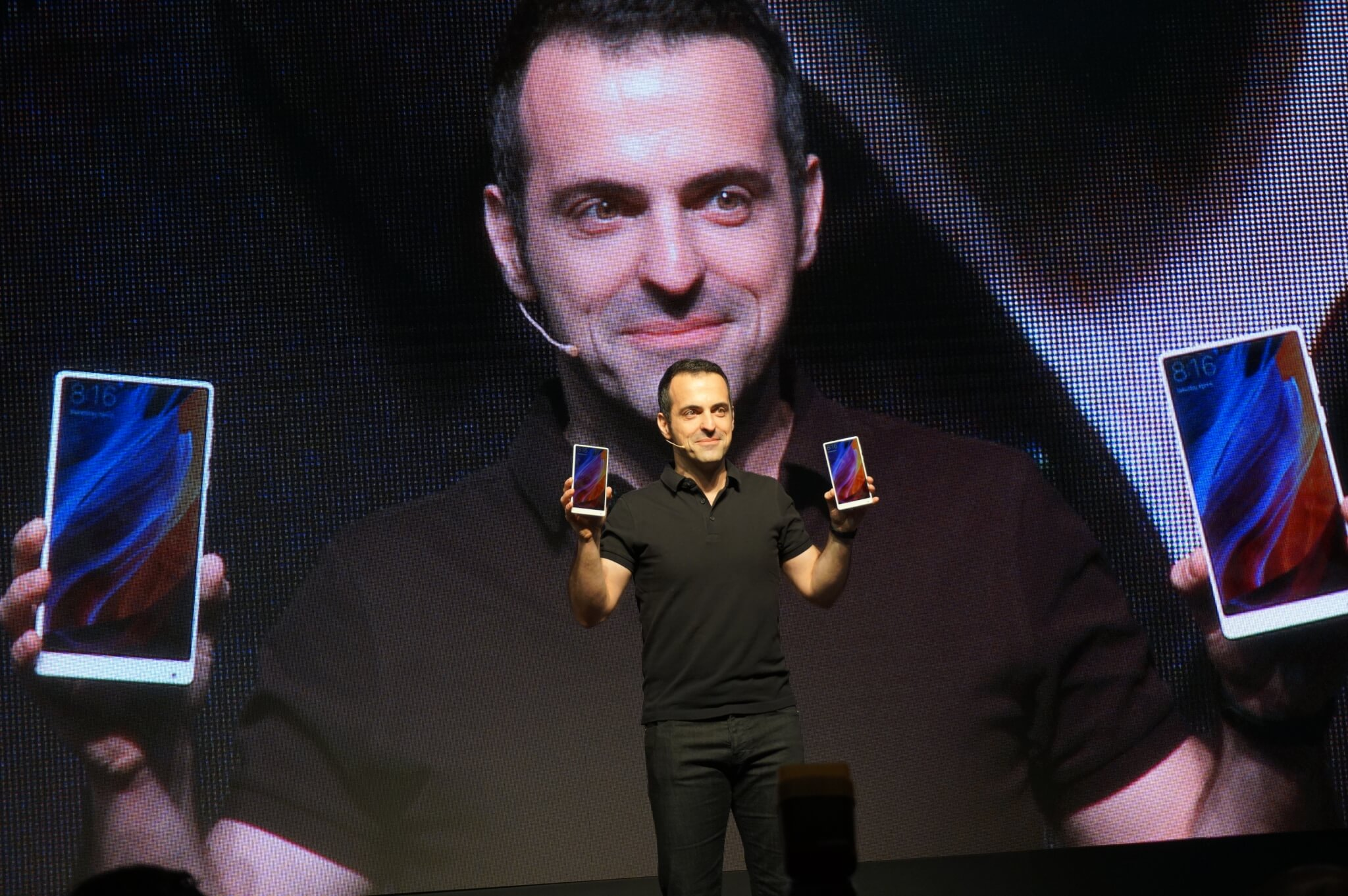 Xiaomi's Hugo Barra holds up the white version of the Mi Mix smartphone.