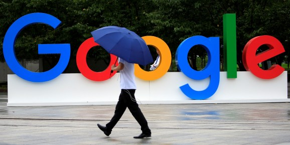 google-umbrella-man Google will reverse cryptocurrency ad ban in the U.S. and Japan