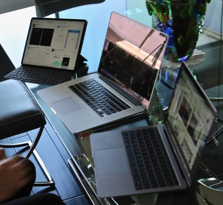 A 12.9-inch iPad Pro next to a 15-inch MacBook Pro and 13-inch MacBook Air.