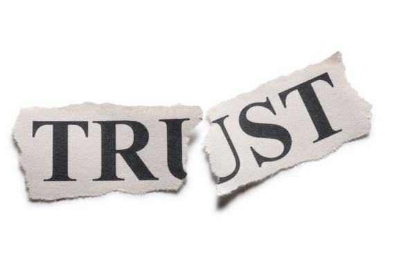 "The word ""Trust"" torn in half"