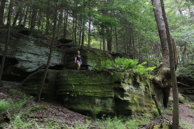 Haley stands on top of mossy ledges