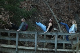 Haley and her roommates play on the bridge