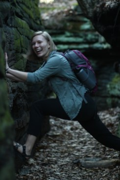 Haley climbs the ledges and leans in laughing