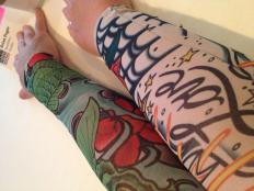 Bob is now proud owner of the tattoo sleeve on the right.