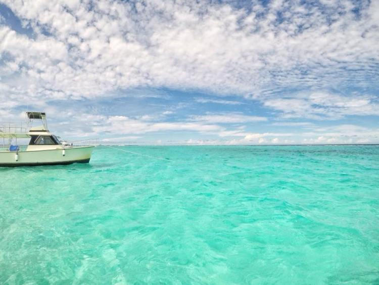 A boat visiting the famous blue waters of Sting Ray City off of Grand Cayman