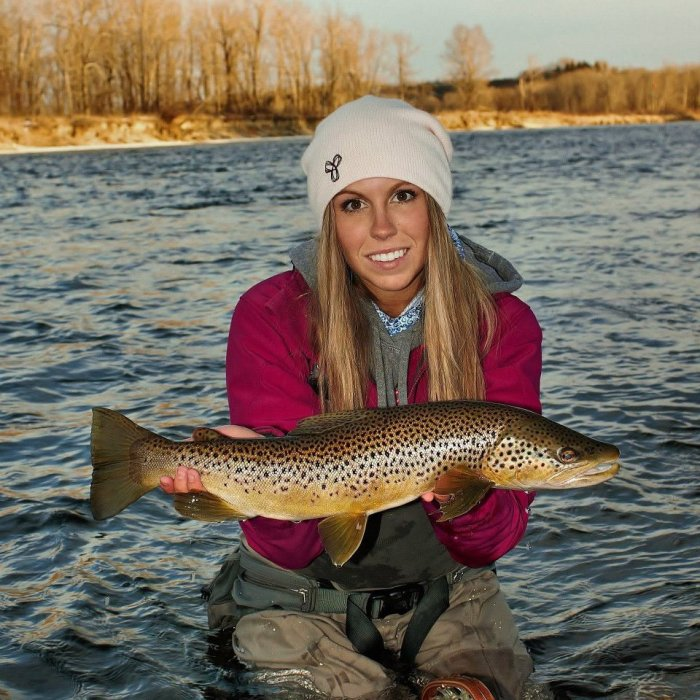Paula Shearer prepares to release a heavy brown trout. (Photo: Kyle Snarr)