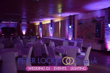 Purple-uplighting-in-Antrobus-Village-Hall-Cheshire