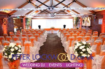 orange-wedding-lighting-in-the-horseshoe-suite-at-the Boholt Country Park
