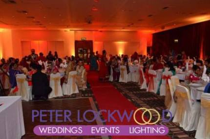 Village-Hotel-Blackpool-red-and-gold-wedding-lighting