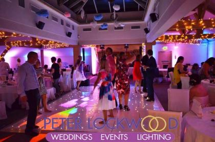 pink-and-blue-wedding-lighting-along-with-fairy-lights-wraped-around-the-oak-beams-at-the-white-hart-saddleworth