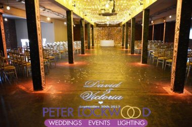 victoria warehouse wedding monogram fairy light canopy and backdrop