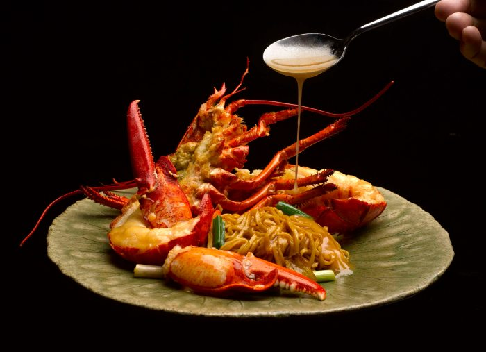 stewed boston lobster noodles with ginger and spring onions