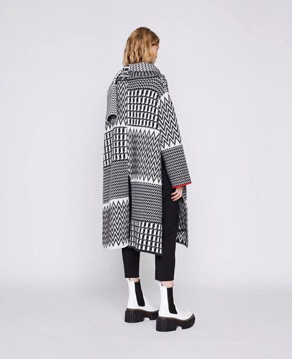 Stella McCartney outfit F/W 2020 with white emillie boot with pattern black and white coat