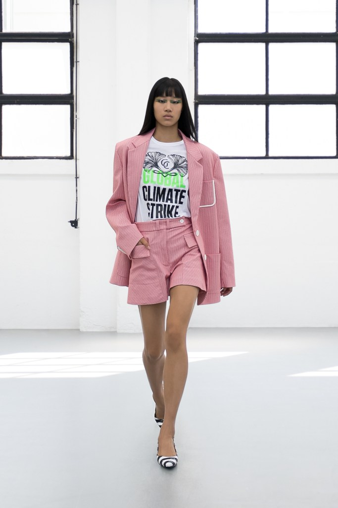 """Gilberto-Calzolari-SS2021-21 a combination of pink shorts and blazer with white t-shirt and saying """"climate strike"""""""